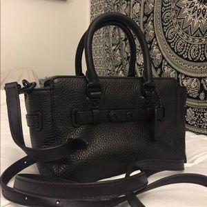 A Coach mini purse